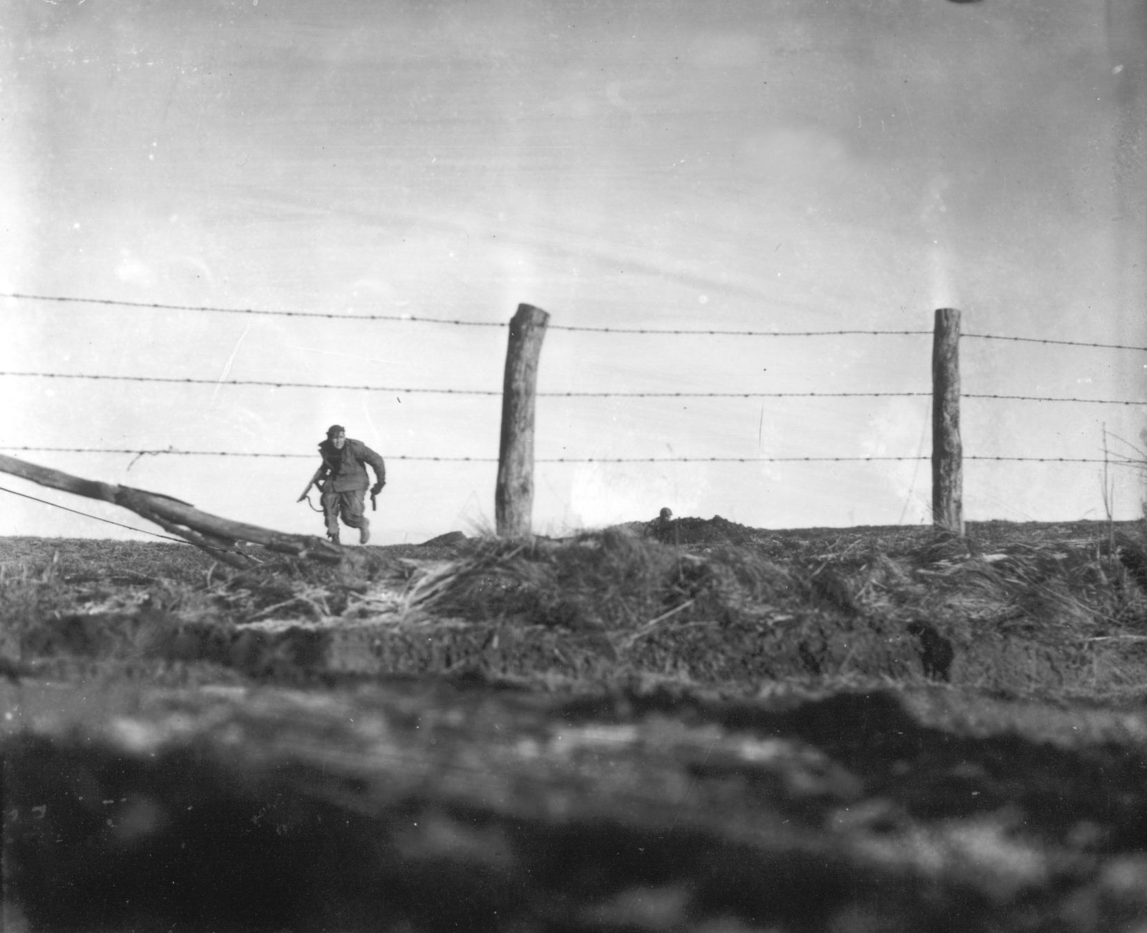 A soldier from the 82nd Airborne Division goes out on a one-man sortie while covered by a comrade in the background, near Bra, Belgium, on December 24, 1944.