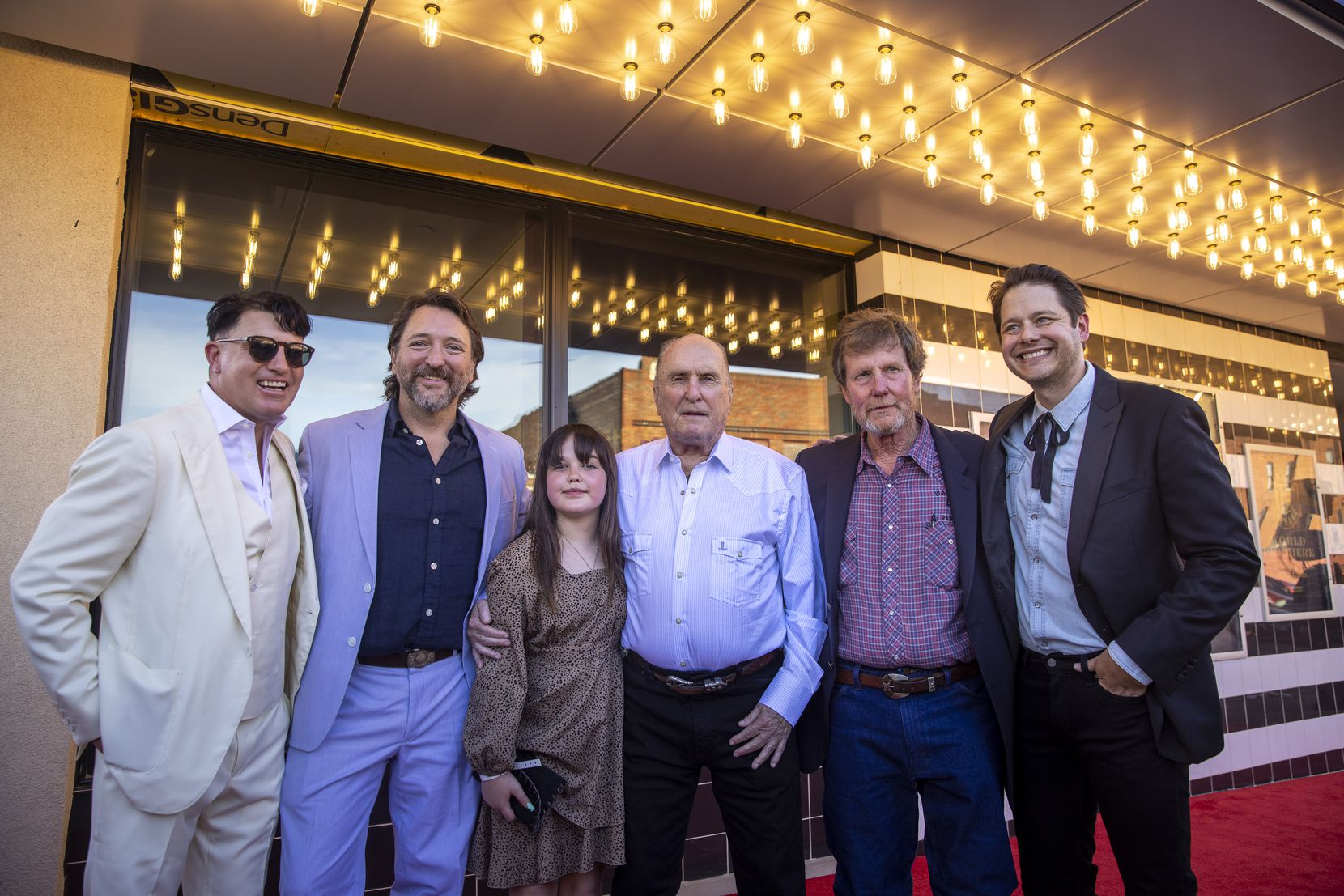 """From left: Co-producer and actor Lane Garrison, director Ty Roberts, Margarita Olympia McConaughey, actors Robert Duvall and Mike """"Rooster"""" McConaughey, and producer Houston Hill attend the premiere of """"12 Mighty Orphans"""" held at the ISIS Theater in Fort Worth on Monday."""