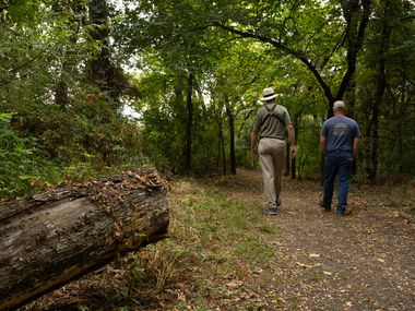 Groundwork Dallas board member Garrett Boone, left, and Rick Buckley, the executive director of the nonprofit, hiked Wednesday on one of the trails in the new Frasier Dam Recreation Area in northwest Dallas.