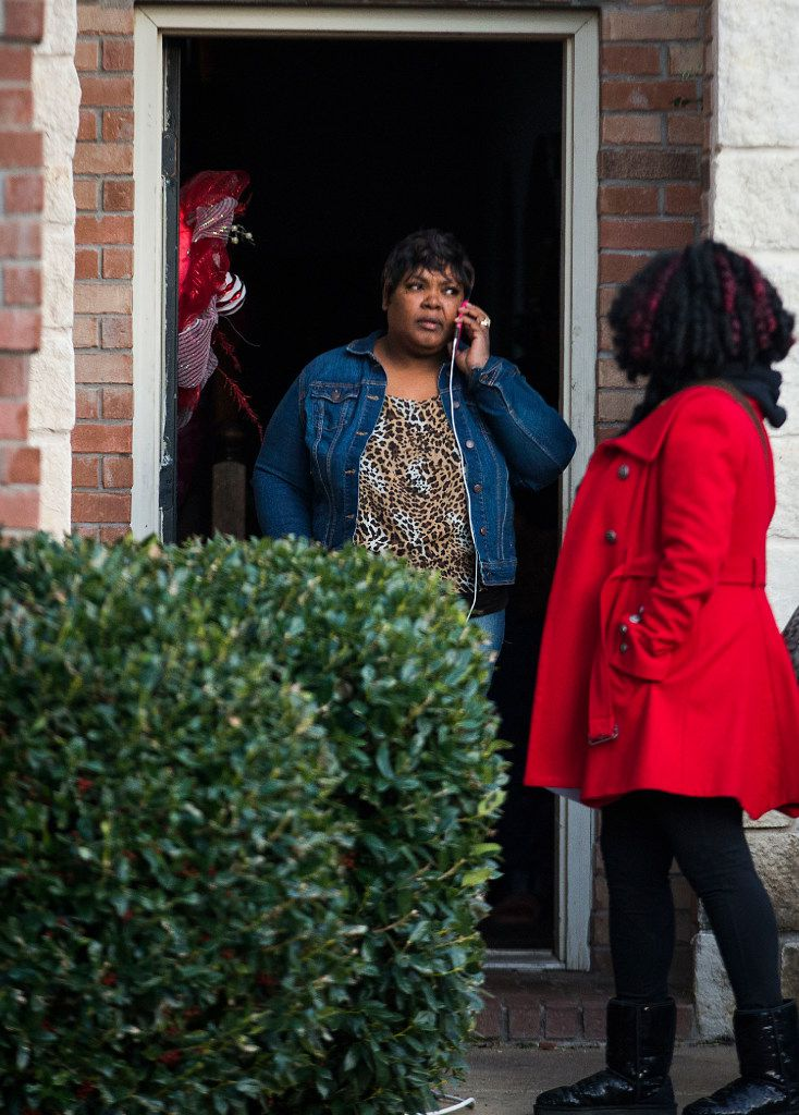 Jacqueline Craig talks on the phone as she leaves her house with attorney Jasmine Crockett on Thursday in Fort Worth. Police were investigating the arrest of Craig and her two daughters on Wednesday by a Fort Worth officer who was caught on video wrestling Craig to the ground and pointing a stun gun at her daughter