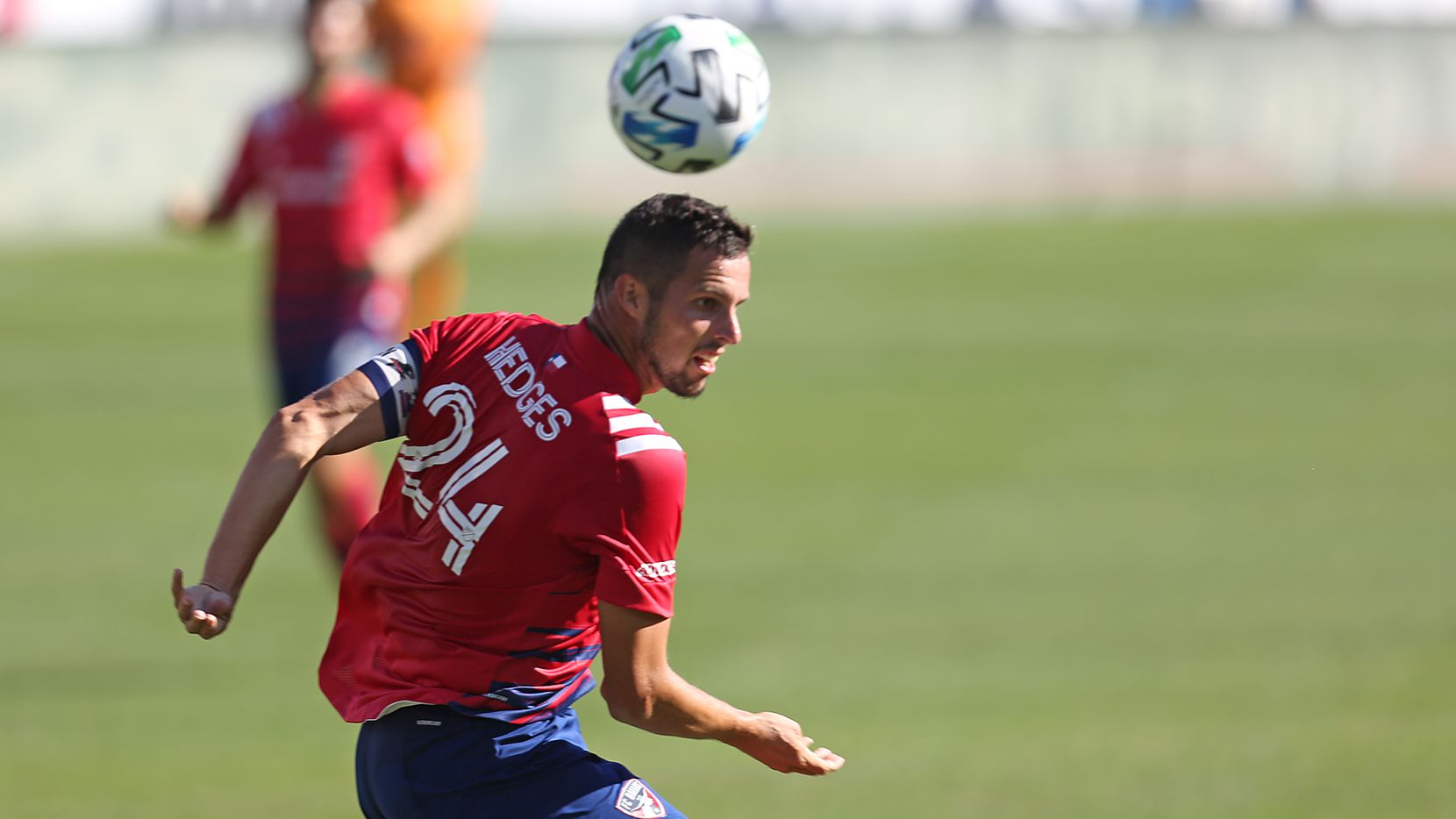 FRISCO, TX - OCTOBER 31: Matt Hedges #24 of FC Dallas head the ball during the MLS game between Houston Dynamo and FC Dallas at Toyota Stadium on October 31, 2020 in Frisco, Texas.