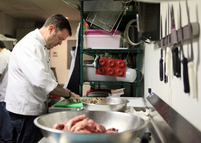 Chef-owner Abraham Salum prepares dumplings at his restaurant in 2013.