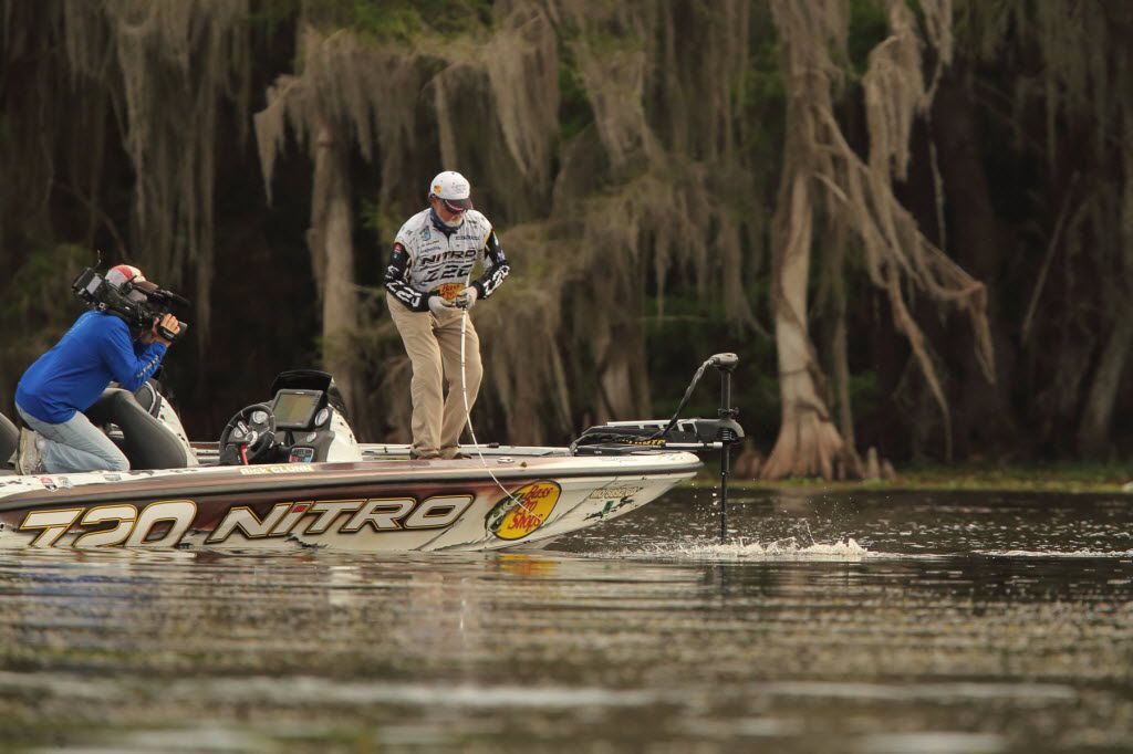 Rick Clunn, 69, is filmed fighting a large bass during the Bassmaster Elite Series tournament on Florida s St. Johns River. Clunn easily won the event and became the oldest angler to win a B.A.S.S. tournament.