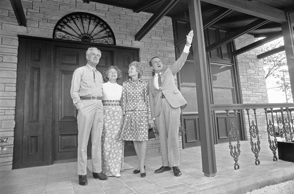 Then-Treasury Secretary John Connally, left, and his wife, Nellie, stand on the front porch of their ranch home in South Texas with President  Richard M. Nixon and his wife, Pat, their house guests for the at night on Sunday, April 30, 1972 in Floresville.