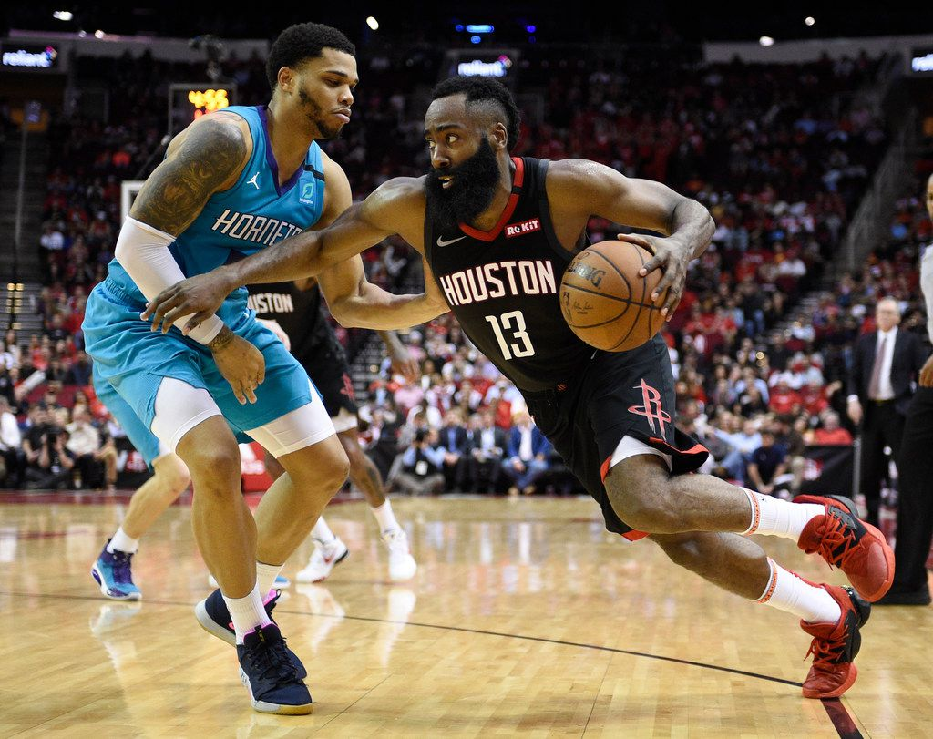 Houston Rockets guard James Harden (13) dribbles around Charlotte Hornets forward Miles Bridges during the second half of an NBA basketball game Tuesday, Feb. 4, 2020, in Houston. (AP Photo/Eric Christian Smith)