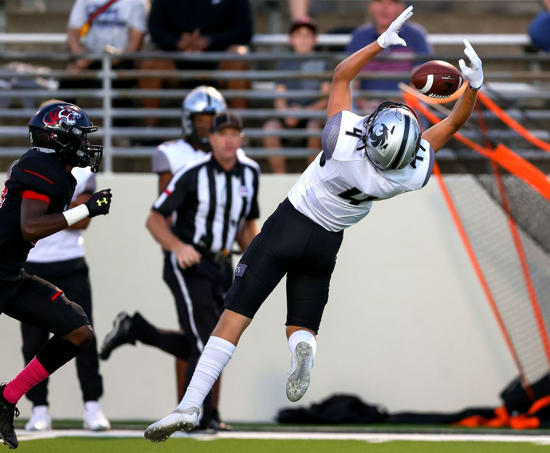 Denton Guyer wide receiver Brody Noble (4) tries to come up with a reception against Denton Braswell defensive back Ayoub Githii (L) during the first half in a District 5-6A high school football game played at the C.H. Collins Complex on Friday, October 8, 2021, in Denton. (Steve Nurenberg/Special Contributor)