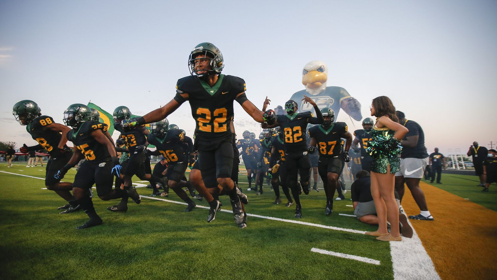 DeSoto junior defensive back Jamarion Ravenell (22) and his teammates take the field for the first half of a high school football game against Duncanville at DeSoto High School, Friday, September 17, 2021.