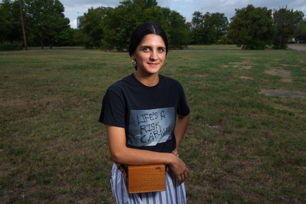 Sofia Bastidas poses for a photograph in an empty lot in the former Jeffries-Meyers neighborhood near Fair Park.