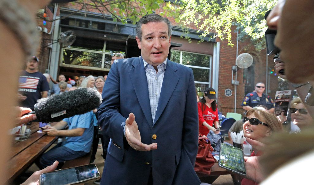 Sen.Ted Cruz does an interview before speaking to the crowd as he campaigns at the Katy Trail Ice House Outpost in Plano, Texas on October 4, 2018.