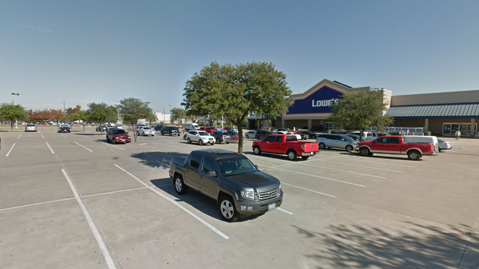 The victim and her two young children were in the parking lot of the Lowe's in the 800 block of Steger Towne Drive just after noon Wednesday.