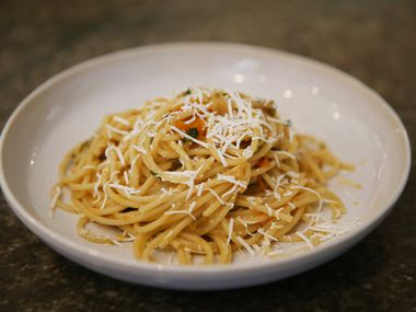Spaghetti with Sun Gold Tomatoes, Pickled Jalapeño, Ricotta Salata and Basil, created by Chef Julian Barsotti of Nonna, Carbone's Fine Food and Wine, and Sprezza.