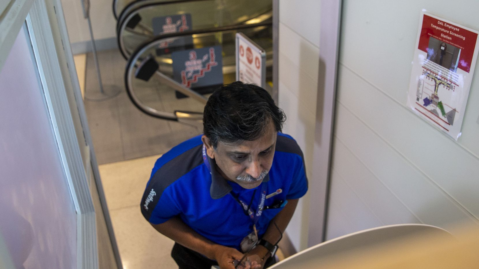 Southwest Airlines customer service supervisor Arshad Khan goes through a temperature check at a Wello thermal imaging kiosk at an employee screening station at Dallas Love Field.
