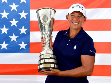 Angela Stanford of the United States poses with the trophy after victory in the Evian Championship during Day Four of The Evian Championship 2018 at Evian Resort Golf Club on September 16, 2018 in Evian-les-Bains, France.