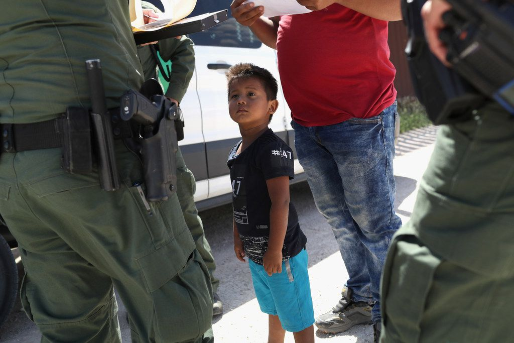 A boy and his father from Honduras are taken into custody by U.S. Border Patrol agents near the U.S.-Mexico Border near Mission. The asylum seekers were then sent to a U.S. Customs and Border Protection processing center for possible separation.