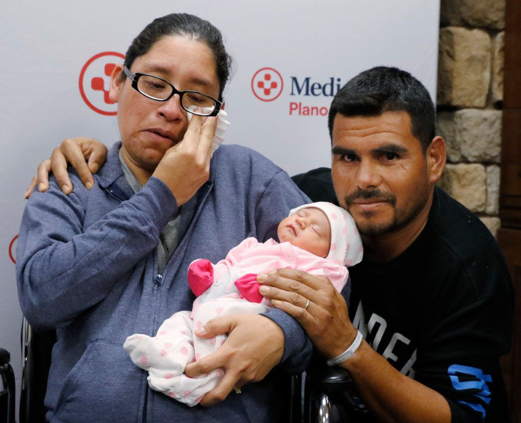 Nora Uribe holds her newborn baby daughter, Ximena, with her husband Antonio Negrete at her side at Medical City Plano on Wednesday, August 30, 2017. Nora Uribe and her family fled Houston ahead of Hurricane Harvey to stay with family in North Texas.