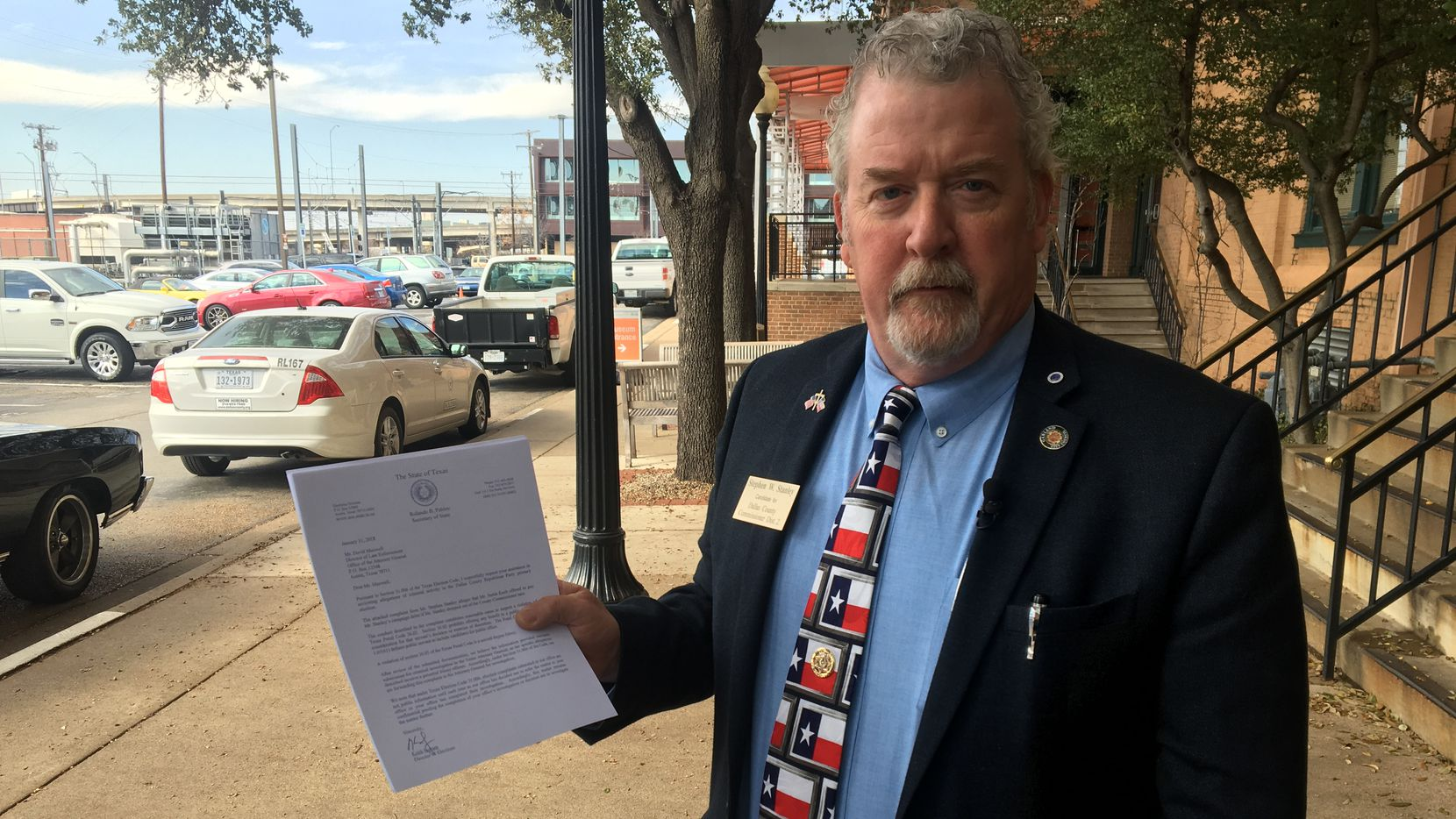 Former Garland City Council member Stephen Stanley holds a copy of a letter requesting a criminal investigation into a complaint he filed against his opponent.