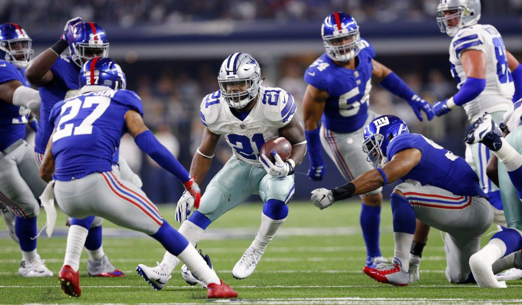 Dallas Cowboys running back Ezekiel Elliott (21) makes a cut against the New York Giants defense as he works to burn down the clock in the fourth quarter at AT&T Stadium in Arlington, Texas, Sunday, September 10, 2017. (Tom Fox/The Dallas Morning News)