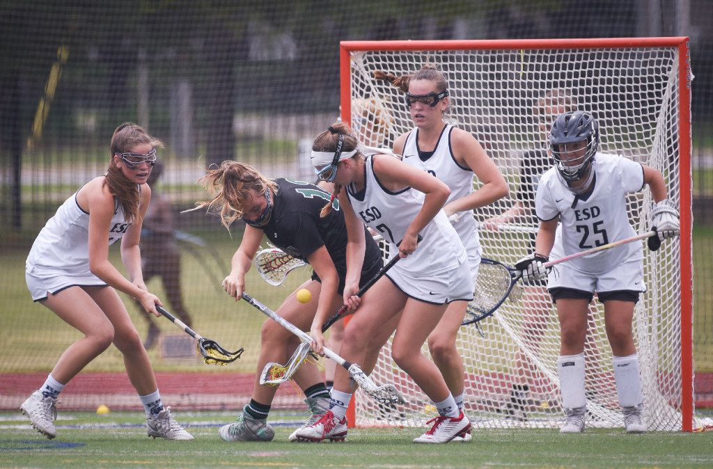Hockaday's Molly Mahowald (3), left, and ESD's Jay Browne (2) fight for the ball during their championship lacrosse game at Jones Stadium in April.