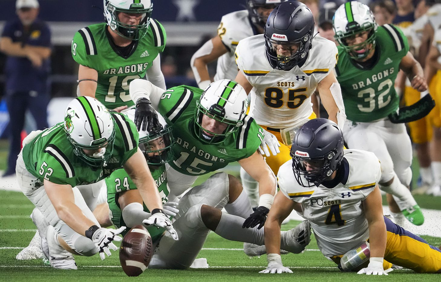 Southlake Carroll defensive lineman Cade Parks (52) recovers a fumble by Highland Park running back Christian Reeves (4) that was caused by a hit from Carroll defensive back Max Reyes (24) during the second half of a high school football game at AT&T Stadium on Thursday, Aug. 26, 2021, in Arlington.