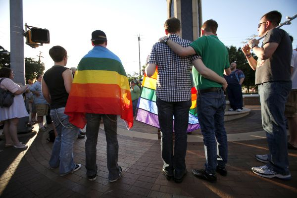Participants listen to speakers during a rally in Oak Lawn, planned as a protest of North Carolina's vote to ban same-sex marriage in its constitution. Two Texas judges say they have the constitutional right to refuse to perform same-sex marriage ceremonies due to their religious faith.