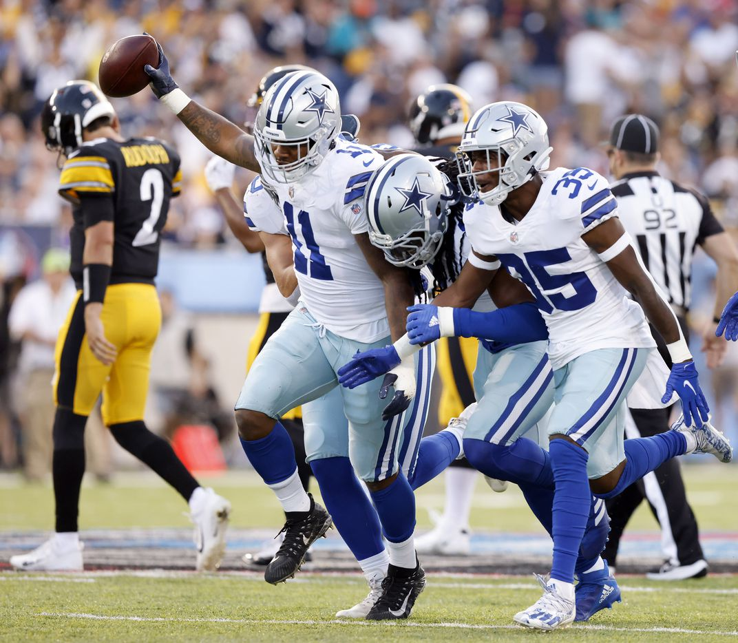 Dallas Cowboys linebacker Micah Parsons (11) celebrates his fumble recovery of Pittsburgh Steelers quarterback Mason Rudolph (left) during the first quarter of their preseason game at Tom Benson Hall of Fame Stadium in Canton, Ohio, Thursday, August 5, 2021. Joining him on the jubilation is linebacker Jaylon Smith (9) and safety Damontae Kazee (35).  (Tom Fox/The Dallas Morning News)