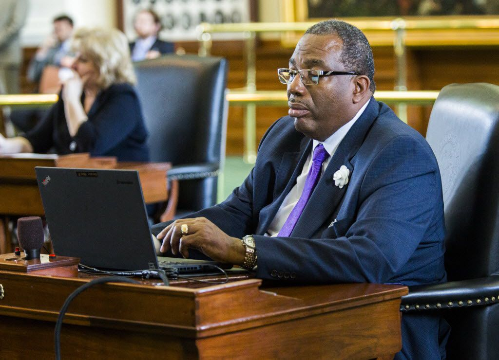 Sen. Royce West, D-Dallas, works at his desk during the final day of the 84th Texas Legislature's regular session. (2015 File Photo/Ashley Landis)