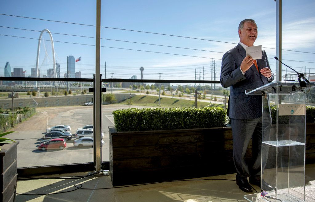 Mayor Mike Rawlings jokingly holds up a envelope with a check from the Simmons family during the announcement of their donation to the City of Dallas Monday, October 31, 2016 in Dallas. The family donated $50 million, which will help fund a large, urban park planned for the Trinity River levee area near downtown Dallas. (G.J. McCarthy/The Dallas Morning News)