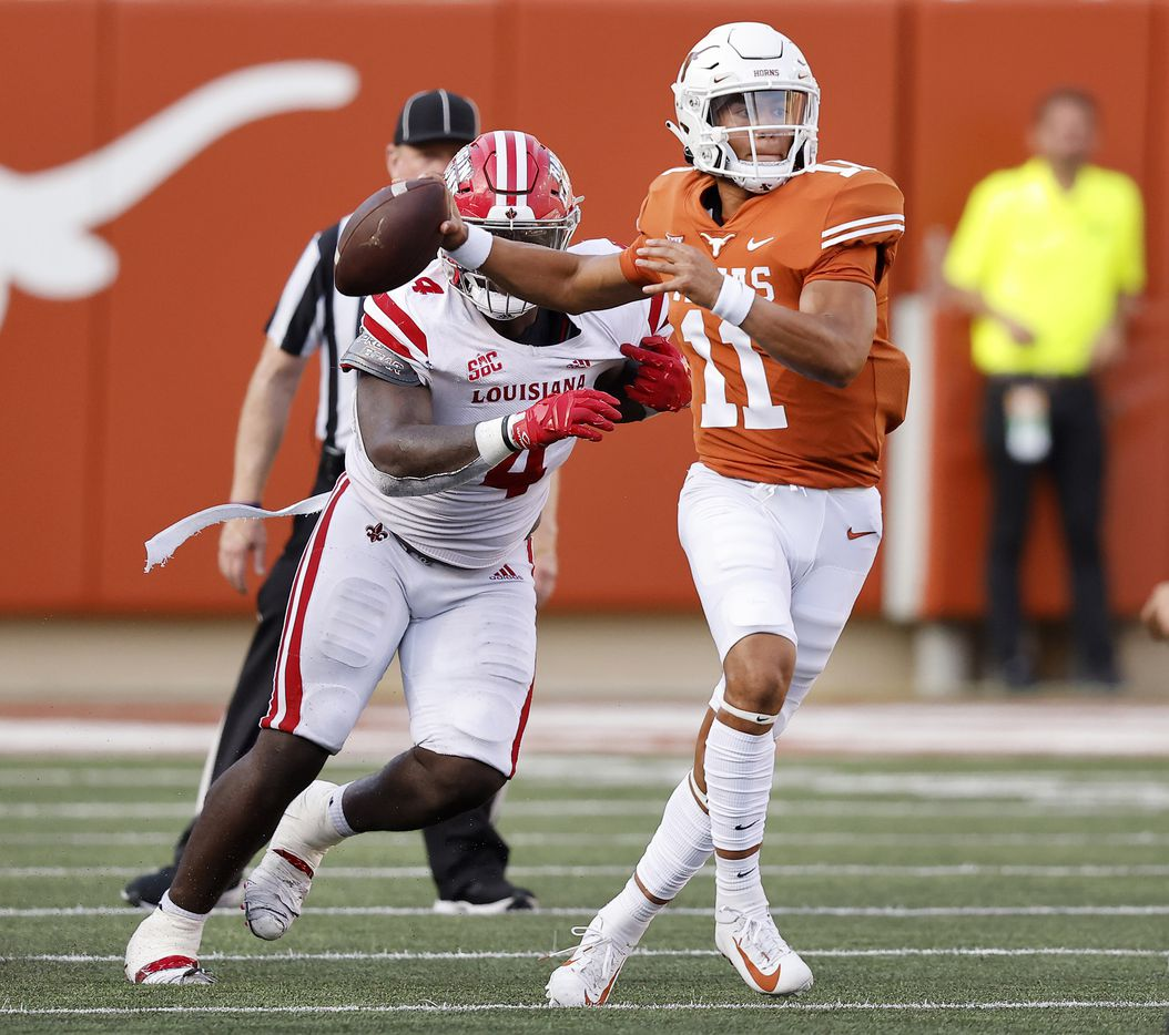 Texas Longhorns quarterback Casey Thompson (11) escapes the pass rush of Louisiana-Lafayette Ragin Cajuns defensive lineman Zi'Yon Hill (4) during the fourth quarter at DKR-Texas Memorial Stadium in Austin, Saturday, September 4, 2021. (Tom Fox/The Dallas Morning News)