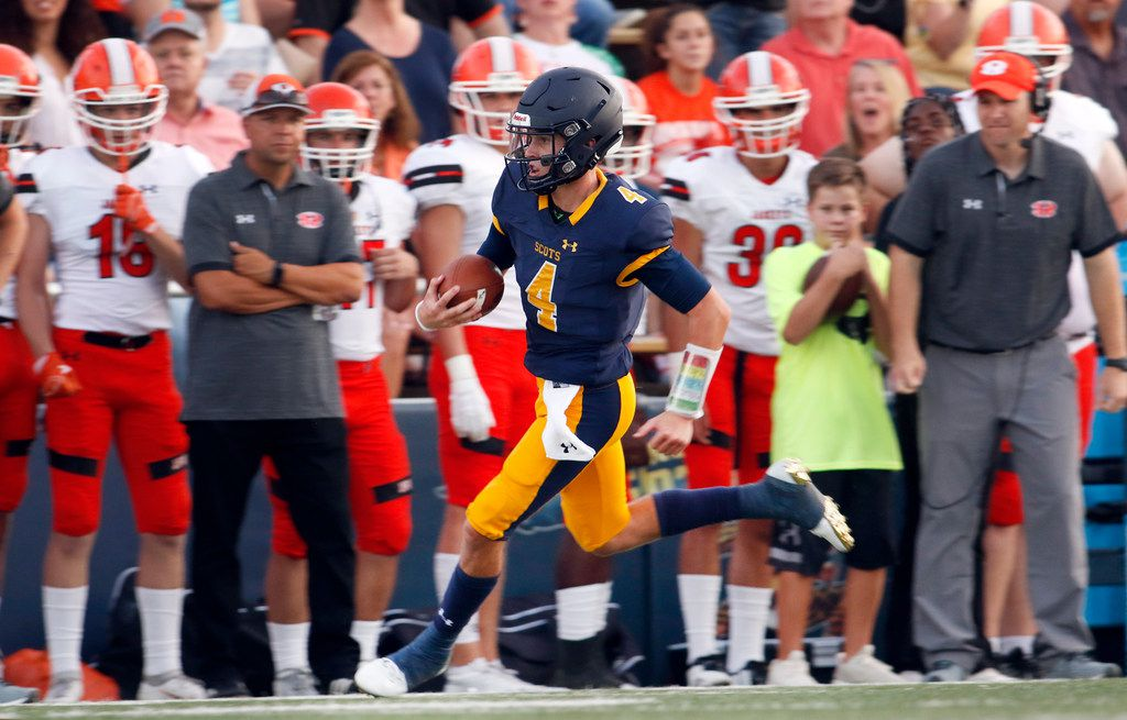 Highland Park quarterback Chandler Morris (4) scampers past the Rockwall bench enroute to a 70-yard rushing touchdown to break a scoreless tie during the first quarter against Rockwall. The two teams played their non-district season opening football game at Highlander Stadium in Highland Park on August 31, 2018. (Steve Hamm/ Special Contributor)