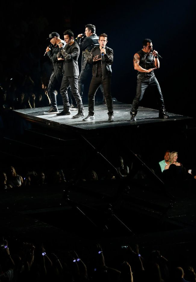 Members of New Kids On The Block Donnie Wahlberg, Joey McIntyre, Danny Wood, Jordan Knight and Jonathan Knight perform on stage during the Total Package Tour at American Airlines Center in Dallas, Tuesday, May 23, 2017. (Jae S. Lee/The Dallas Morning News)