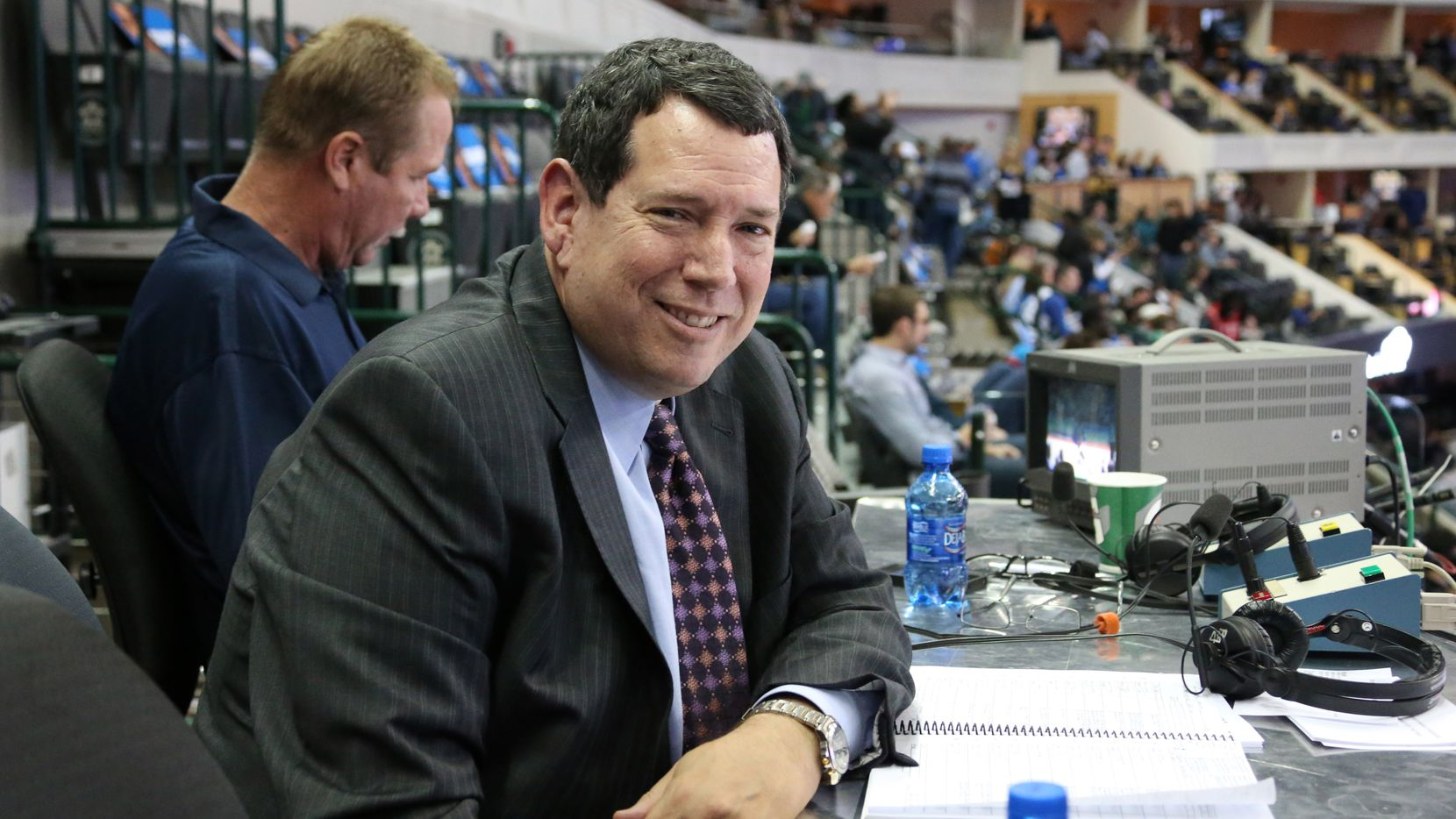 Dallas Mavericks announcer Chuck Cooperstein is pictured during the Houston Rockets vs. the Dallas Mavericks NBA basketball game at the American Airlines Center in Dallas on Wednesday, November 20, 2013.
