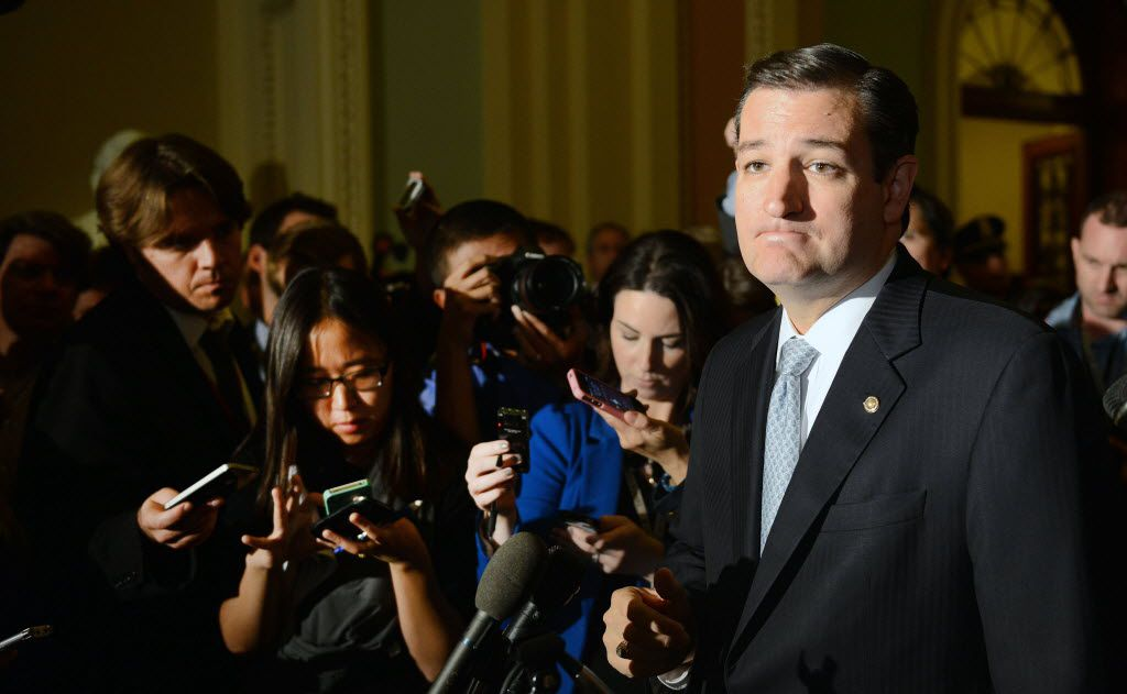 Sen. Ted Cruz (R-TX) pauses as he speaks to the media after Senate leaders announced a deal to end the government shutdown, during a news conference at the U.S. Capitol in Washington, Wednesday, October 16, 2013.