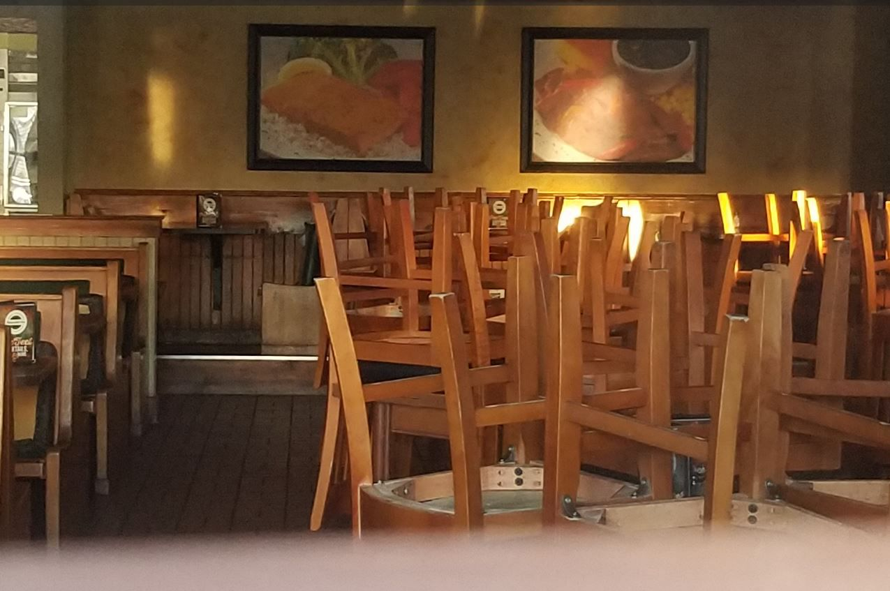 Chairs were neatly stacked on tables during the normal dinner rush on Tuesday at the Black-eyed Pea restaurant in Plano. (Karen Robinson-Jacobs/Staff)