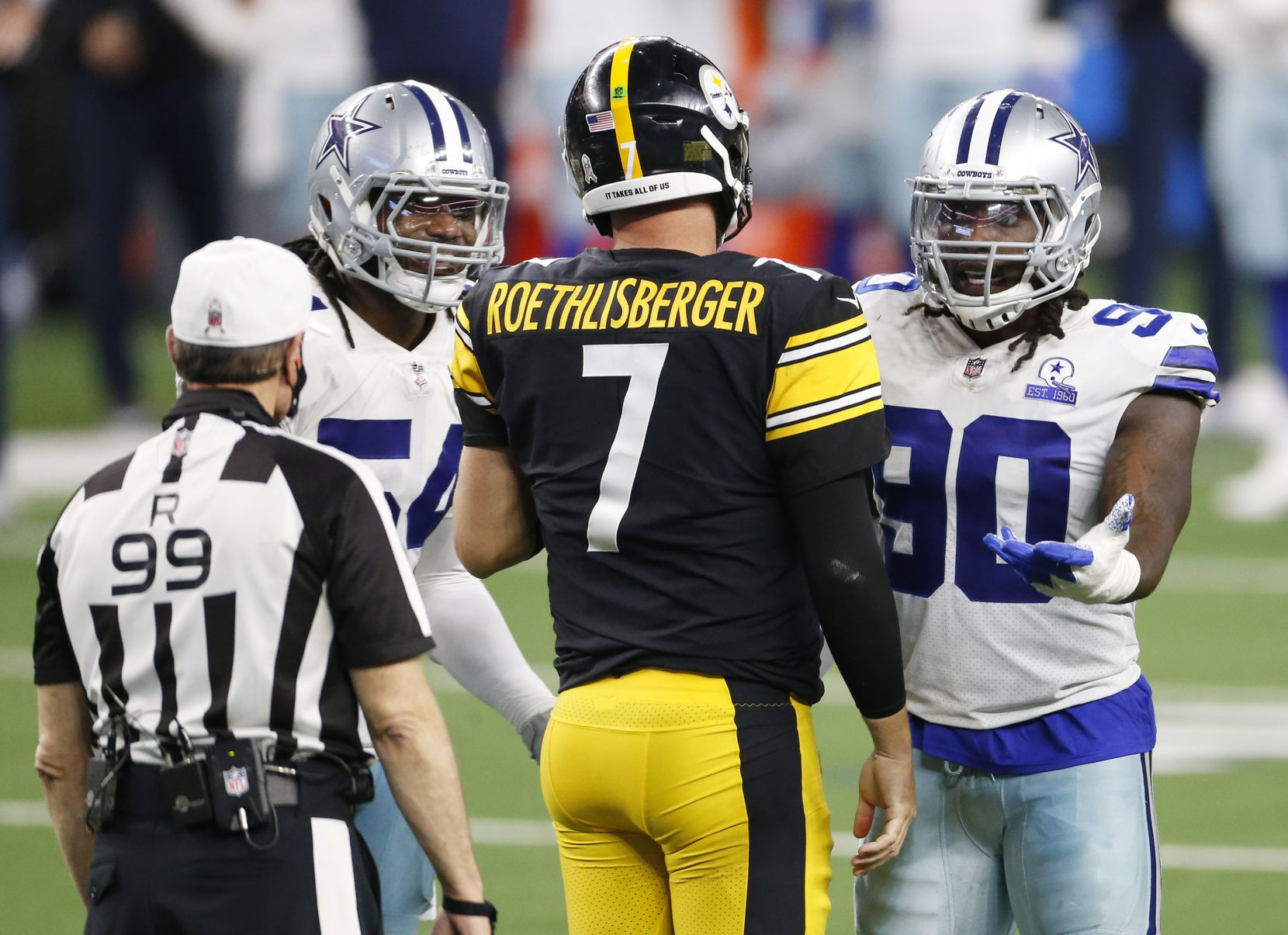 Dallas Cowboys defensive end DeMarcus Lawrence (90) and linebacker Jaylon Smith (54) question a call from referee Tony Corrente (99) as Pittsburgh Steelers quarterback Ben Roethlisberger (7) walks between them at AT&T Stadium in Arlington, Texas on Sunday, November 8, 2020.