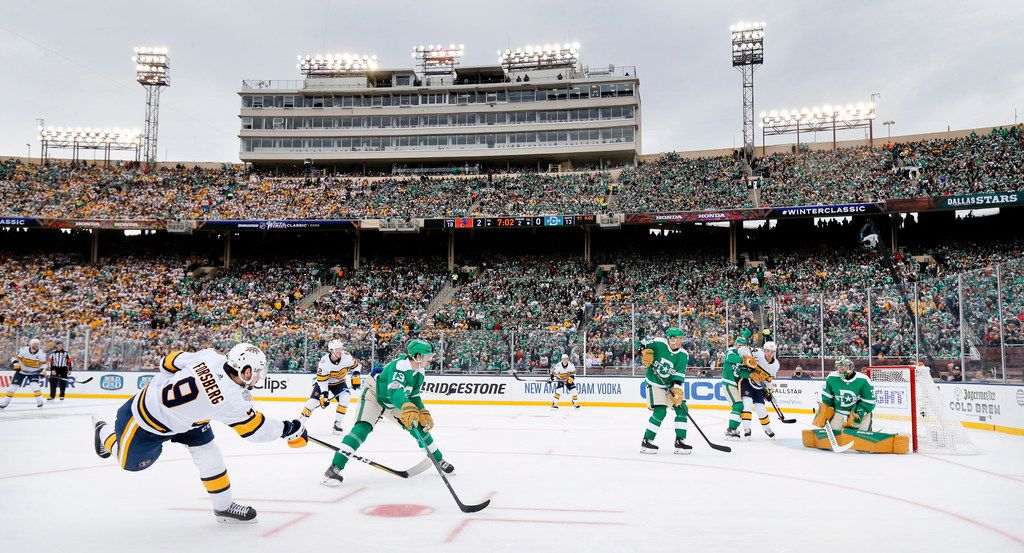Dallas Stars goaltender Ben Bishop (30) deflects a shot by Nashville Predators left wing Filip Forsberg (9) during the second period of the NHL Winter Classic hockey game at the Cotton Bowl in Dallas, Wednesday, January 1, 2020. (Tom Fox/The Dallas Morning News)