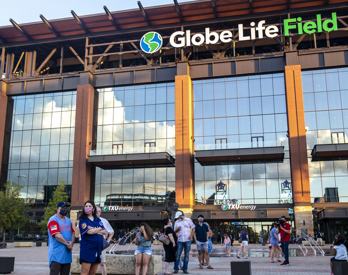 Fans eat and gather during opening day of the Texas Rangers season outside of the Globe Life Field stadium in Arlington, Texas, on Friday, July 24, 2020. The Rangers played the Colorado Rockies at the new Globe Life Field stadium, but fans had to watch on televised screens outside due to the ongoing pandemic. (Lynda M. Gonzalez/The Dallas Morning News)