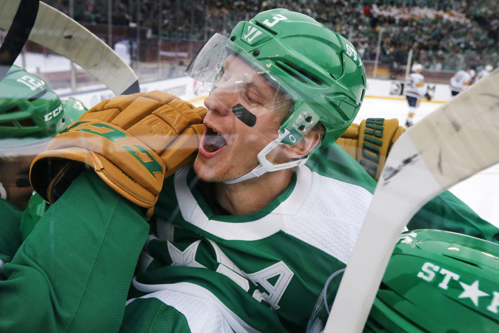 Dallas Stars defenseman John Klingberg (3) joins the celebration after Andrej Sekera scored during the third period of the NHL Winter Classic hockey game at the Cotton Bowl in Dallas, Wednesday, January 1, 2020. The Stars came back to win, 4-2.