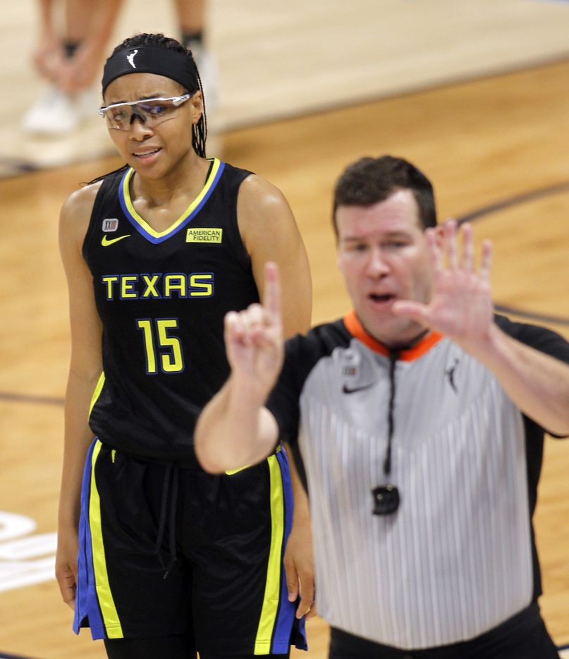 Dallas Wings guard Allisha Gray (15) reacts as a game official signals her jersey number to the scorer's table as she was charged with a foul during first half action against the Atlanta Dream. The two teams played their WNBA game at College Park Center on the campus of UT-Arlington on September 5, 2021. (Steve Hamm/ Special Contributor)
