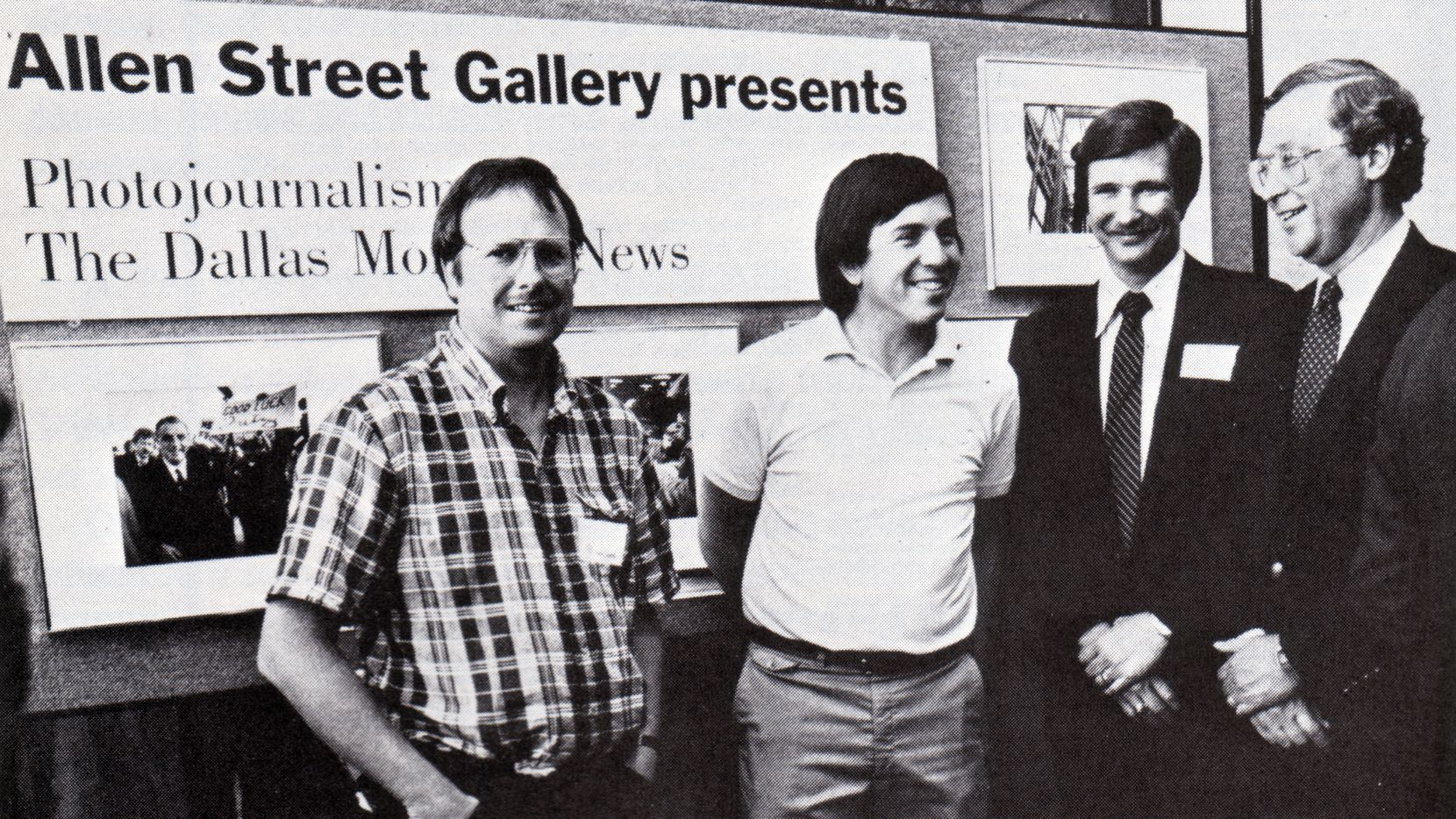 In 1984, Dallas Morning News photographers (from left) Randy Eli Grothe  and David Woo talk with executive Editor Ralph Langer (far right) about their photos at a preview of an exhibition. The man who's second from right was not identified.