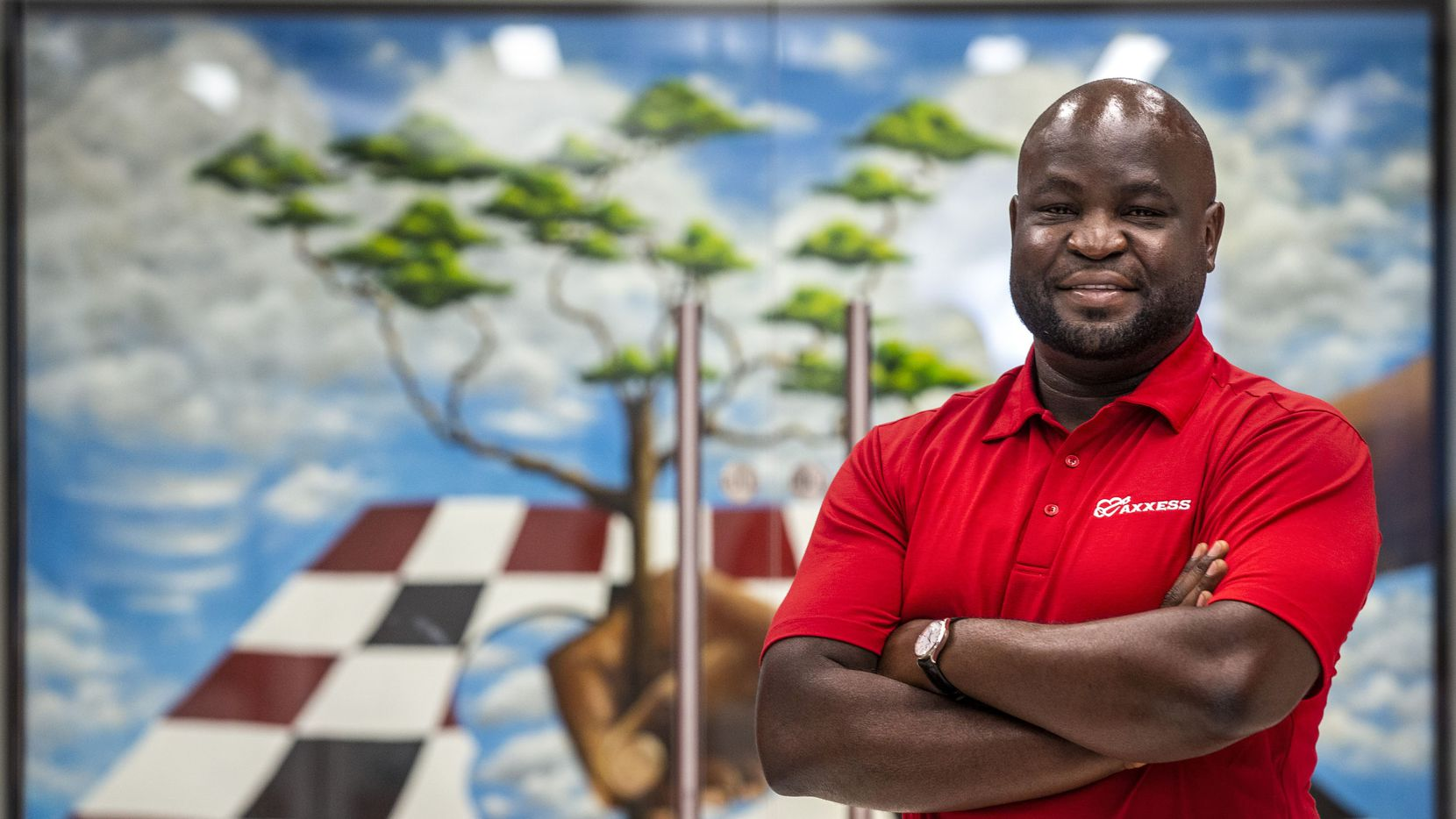 John Olajide, CEO of Axxess and chairman of the Dallas Regional Chamber, posed for a portrait at the Axxess offices in Dallas in July.