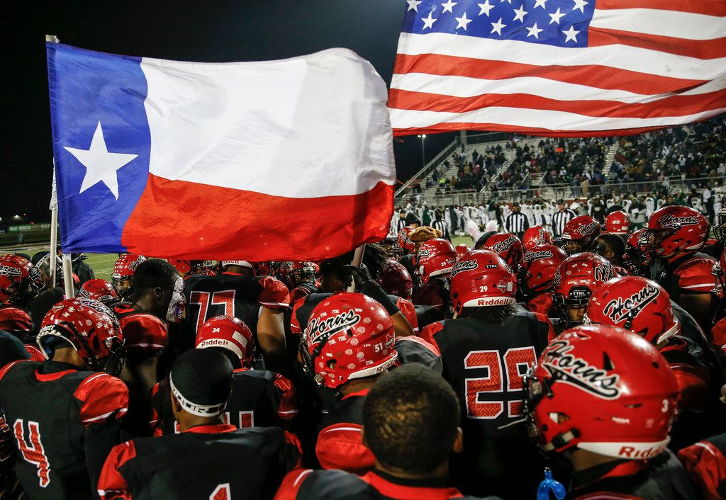 The Cedar Hill Longhorns gather prior to a high school football match up between Cedar Hill and DeSoto on Thursday, Nov. 7, 2019. (Ryan Michalesko/The Dallas Morning News)