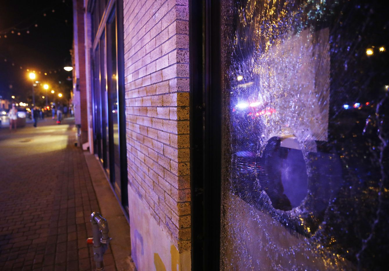 Busted window of a business along Main Street in Deep Ellum in downtown Dallas, on Friday, May 29, 2020. George Floyd died in police custody in Minneapolis on May 25.