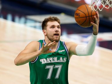 Mavericks guard Luka Doncic (77) goes up for a layup against the Hornets during the first quarter of play at American Airlines Center on Wednesday, Dec. 30, 2020, in Dallas.