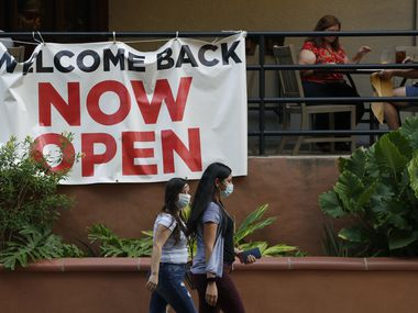 In late May, visitors to the San Antonio River Walk passed a restaurant that had reopened. Texas continues to reopen in the wake of the COVID-19 pandemic.