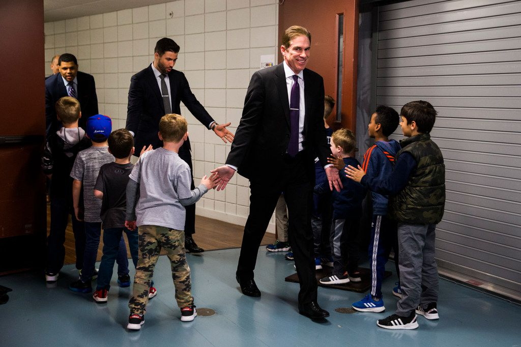 Southern Methodist Mustangs head coach Tim Jankovich and other coaches and staff are greeted by children as they walk from the locker room to the court before a basketball game between SMU and University of Houston on Saturday, February 15, 2020 at Moody Coliseum in Dallas. (Ashley Landis/The Dallas Morning News)