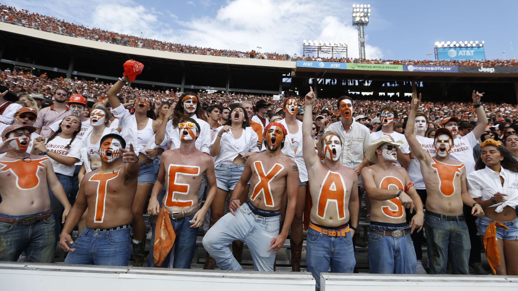 Texas Longhorns fans cheer for their team during the second half of play at the Cotton Bowl in Dallas on Saturday, October 6, 2018. Texas Longhorns defeated Oklahoma Sooners 48-45.