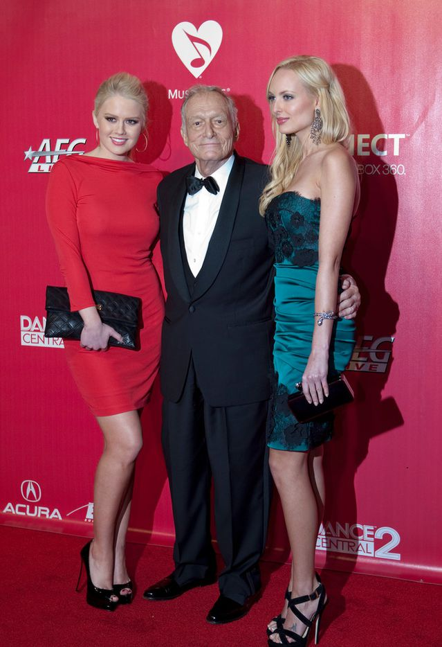 Hugh Hefner, with two Playboy Bunnies, arrives on the red carpet for the 2012 MusiCares' Person of the Year gala honoring Paul McCartney at the Los Angeles Convention Center on February 10, 2012.