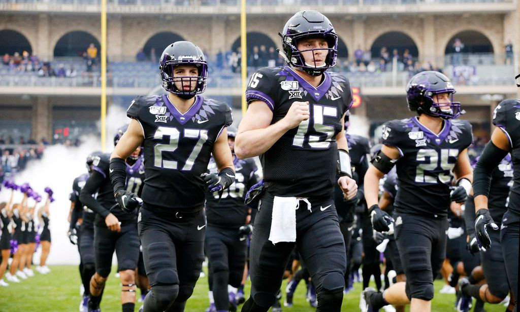 TCU Horned Frogs quarterback Max Duggan (15) leads his team onto the field to face the West Virginia Mountaineers at Amon G. Carter Stadium in Fort Worth, Friday, November 29, 2019.