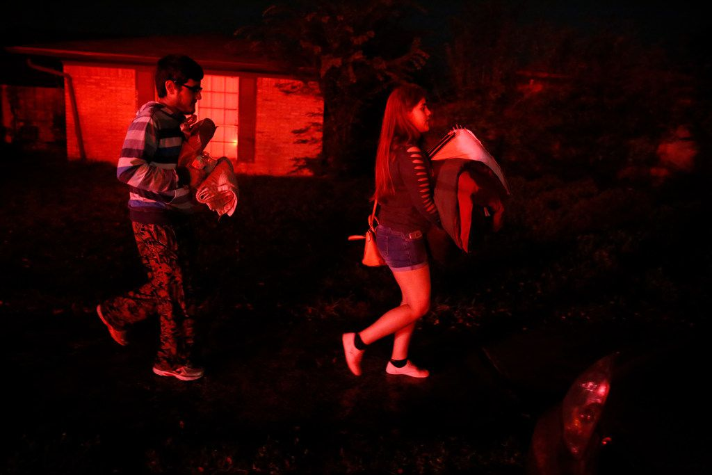 Karime Coronado and her brother evacuated their home on Nogales Drive in Dallas on Wednesday, after residents reported smelling gas leaks. The evacuations came a month after three house explosions due to leaking gas.