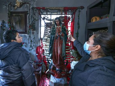 Epigmenia Otero (left) cites the Virgin of Guadalupe as the reason her husband woke up and they managed to leave the burning house. A statue of the Virgin survived the fire after being brought to the house that afternoon.